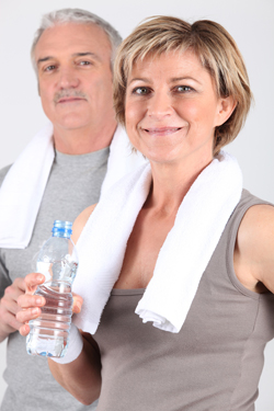Mature couple drinking water small
