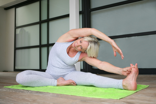 Senior woman practicing yoga small